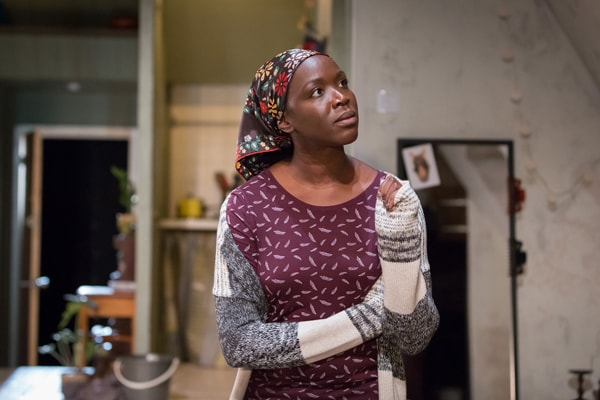 Faith Alabi (Amina) in Belleville at the Donmar Warehouse, directed by Michael Longhurst, designed by Tom Scutt. Photo by Marc Brenner