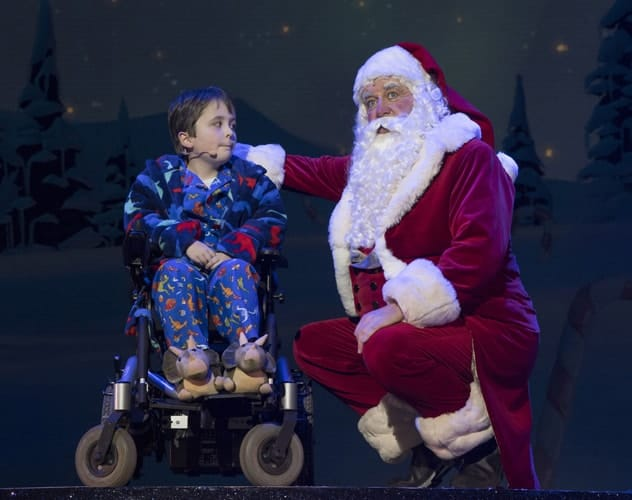 L-R Dan Mclellan (William Trundle) & Santa Claus - The Christmasaurus Live - Eventim Apollo (c) Alastair Muir