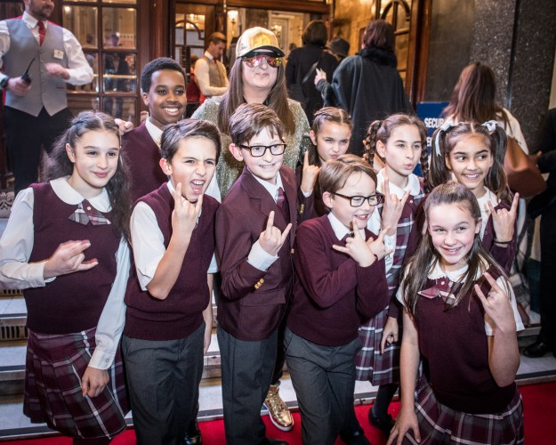 Honey G and kids from the cast of School of Rock The Musical at the Opening Night of Cinderella at the London Palladium - Photo credit Craig Sugden
