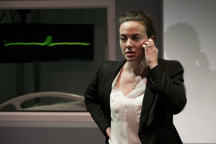 Anne Adams in DRONES, BABY, DRONES at Arcola Theatre. Written by David Greig, Ron Hutchinson and Christina Lamb. Directed by Nicolas Kent and Mehmet Ergen. http://arco.la/drones Photography by Simon Annand