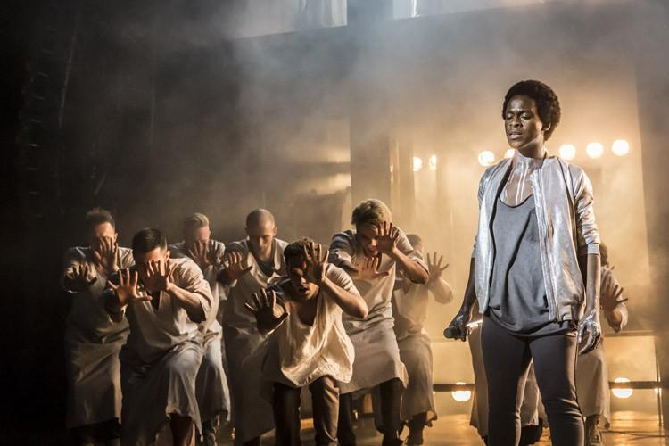 Tyrone Huntley as Judas and Ensemble. Photo Johan Persson.