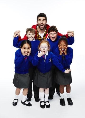 NATIVITY! THE MUSICAL. Simon Lipkin 'Mr Poppy' and the Children of St Bernadette's School. Photo by Simon Turtle