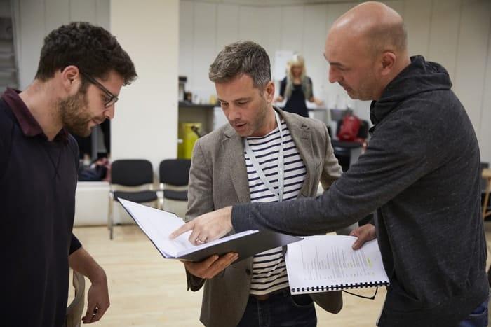 l-r Oscar Toeman (assistant director), Yair Jonah Lotan and Daniel Stewart in rehearsal for 'Oslo' - photo credit Brinkhoff Mögenberg.