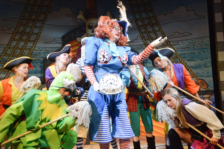 Andrew Pollard as Long Joan Silver with members of the company in Peter Pan A New Adventure at Greenwich Theatre, photo credit Robert Day