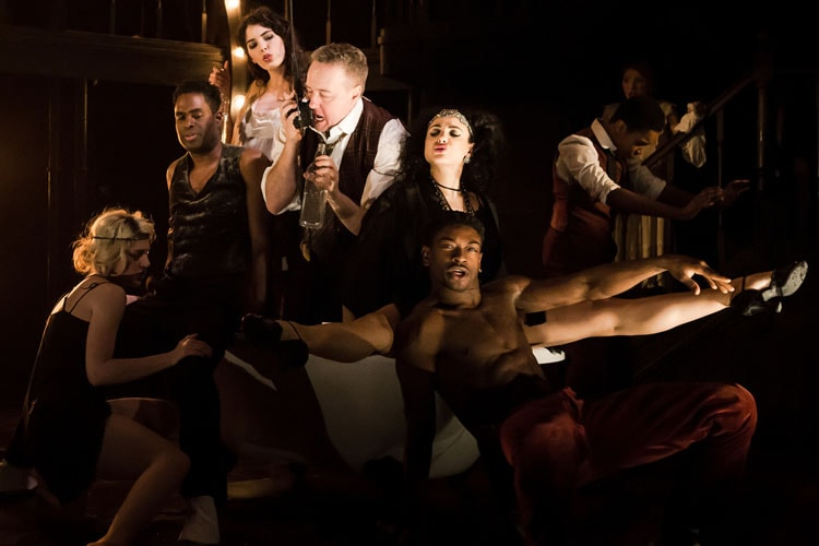 John Owen-Jones as Burrs and Victoria Hamilton-Barritt as Kate (centre) with the cast of The Wild Party. Photo Credit Scott Rylander