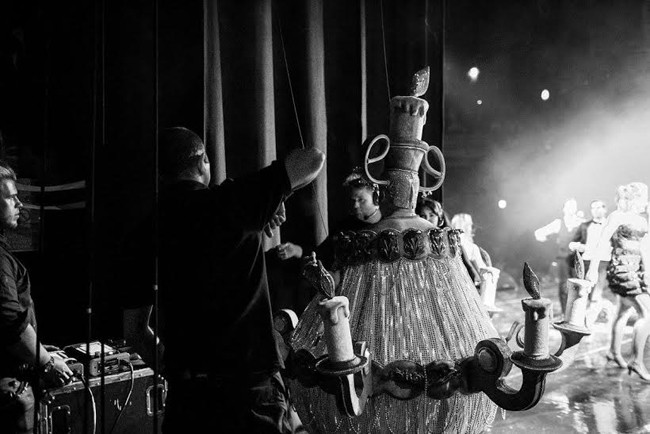 Up! Up! and Away! Final adjustments are made to Biggins' stunning chandelier costume before he sets sail above the Dominion Theatre Photo Derren Bell