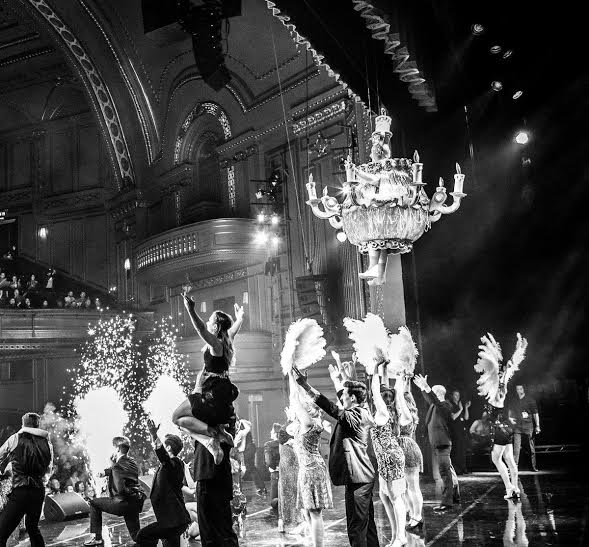 Biggins sparkles as a giant chandelier - the highlight of BE OUR GUEST from Beauty and the Beast Photo Derren Bell