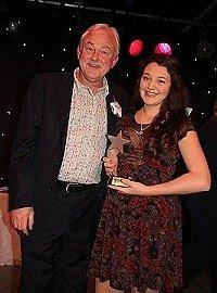 Michael Fenton Stevens presenting Zara Minns with the Liza Goddard comedy award.