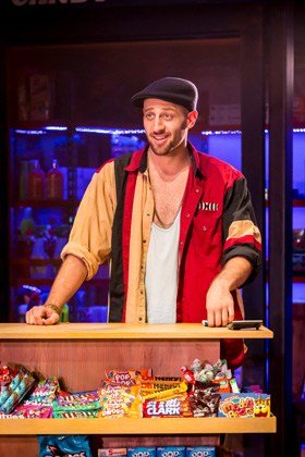 Sam Mackay as Usnavi in In The Heights.