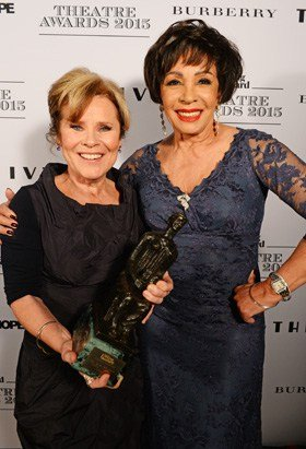Imelda Staunton, winner of the Best Musical Performance award, and presenter Dame Shirley Bassey pose in front of the Winners Boards at The London Evening Standard Theatre Awards in partnership with The Ivy at The Old Vic Theatre on November 22, 2015 in London, England. Pic Credit: Dave Benett