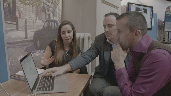 Dr . Teresa Llano from Goldsmiths University explains to Benjamin Till and Nathan Taylor, the workings behind the What-If Machine, the system that has provided the premise for 'Beyond the Fence'.