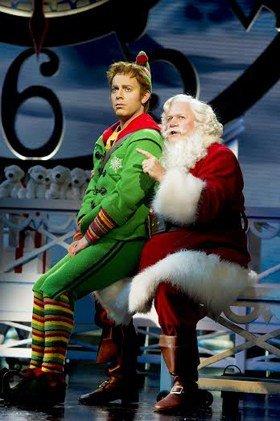 LtoR Ben Forster as Buddy and Mark McKerracher as Santa in Elf credit Alastair Muir