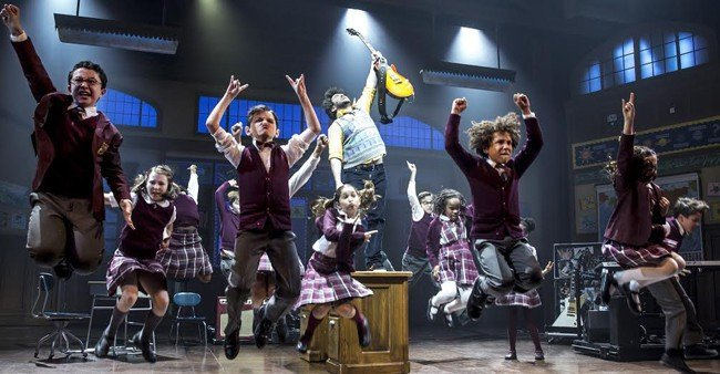 Alex Brightman (centre) and the kids of School of Rock - The Musical Photo