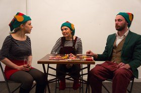 Three Elves Sitting Around Playing Poker