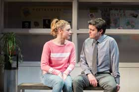Lauren O'Neil (Steph) and Tom Burke (Greg) in Reasons to be Happy at Hampstead Theatre.