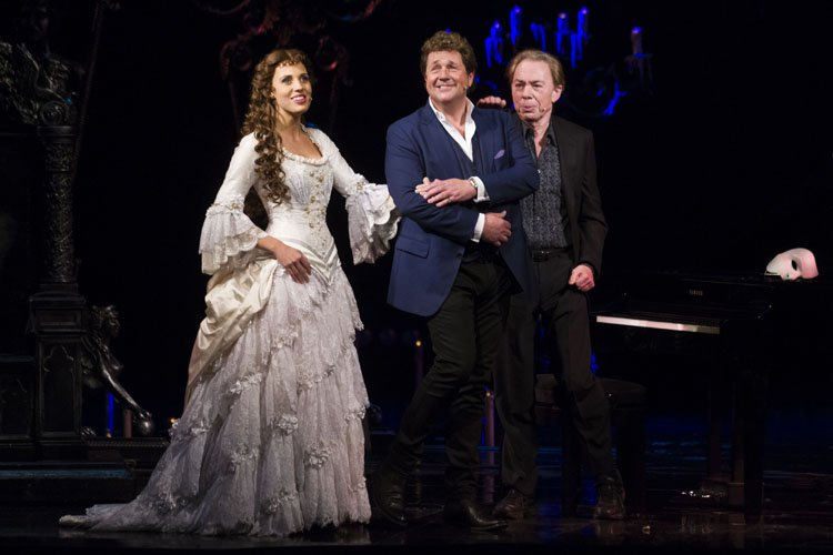 Celinde Schoenmaker (Christine Daae), Michael Ball (Raoul) and Andrew Lloyd Webber (Music) during the curtain call - Photo by Dan Wooller