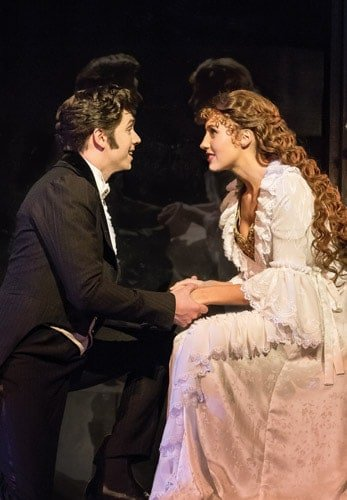 THE PHANTOM OF THE OPERA - Nadim Namaan as 'Raoul' and Celinde Schoenmaker as 'Christine Daaé'. Photo credit Johan Persson