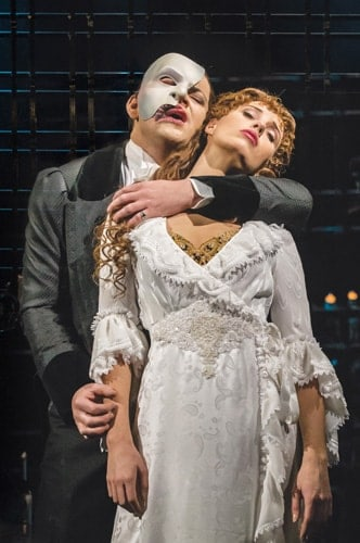 THE PHANTOM OF THE OPERA. Ben Forster as 'The Phantom' and Celinde Schoenmaker as 'Christine Daaé'. Photo credit Johan Persson