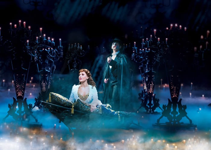 THE PHANTOM OF THE OPERA. Celinde Schoenmaker as 'Christine Daaé' and Ben Forster as 'The Phantom. Photo credit Johan Persson