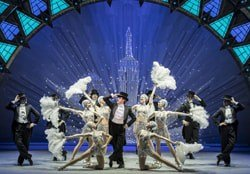 Haydn Oakley, centre, with the cast of An American in Paris at the Dominion Theatre