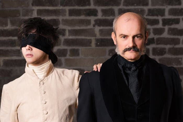 Jérôme Pradon as Dr. Pignier and Jack Wolfe as Louis Braille