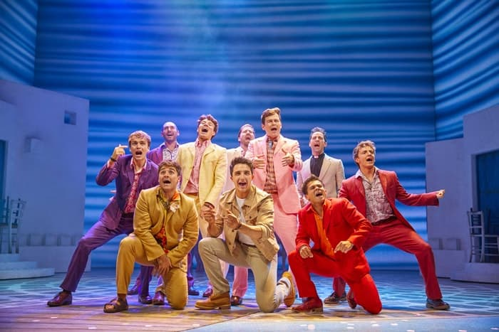 Christopher Jordan-Marshall as Sky (front centre) with the cast of MAMMA MIA! Credit Brinkhoff & Mögenburg