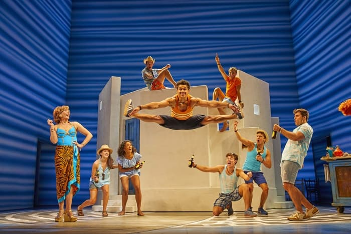 Damien Buhagiar as Pepper (centre) with the cast of MAMMA MIA! Credit Brinkhoff & Mögenburg