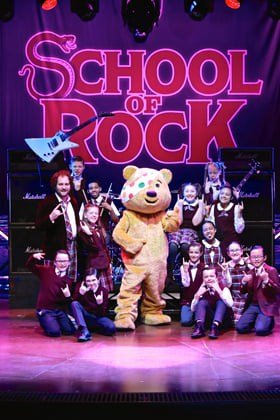 The cast of School of Rock The Musical with Pudsey (photo by Toby Mansfield)