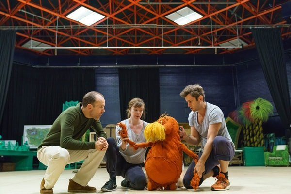 Simon Paisley Day (The Once-ler) and The Lorax - Laura Caldow, Ben Thompson and David Ricardo-Pearce (Puppeteers). Dr. Seuss's The Lorax at The Old Vic. Photos by Manuel Harlan