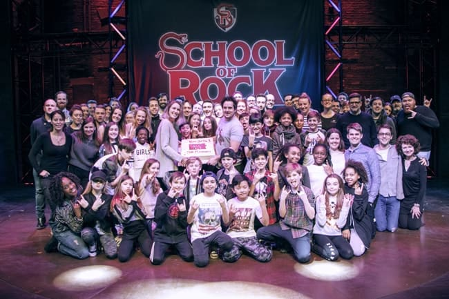 The kids and adult cast gathered on stage before the milestone performance to celebrate the show's achievement.