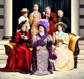 LtoR (Back) Susan Penhaligon, Peter Sandys-Clarke, Thomas Howes, Simon Shackleton, (Front) Kerry Ellis, Gwen Taylor & Louise Coulthard in The Importance of Being Earnest. Credit Jay Brooks