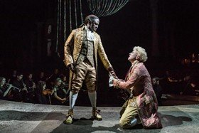Lucian Msamati as Antonio Salieri and Adam Gillen as Wolfang Mozart in Amadeus at the National Theatre - Photo by Marc Brenner