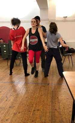 Souz Kempner as Weaver dancing the Sexy Man song with dancers Kate Haughton and Viva Foster