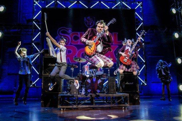 centre Stephen Leask - Dewey Finn and members of the adult cast-of School of Rock. Photo credit Tristram Kenton