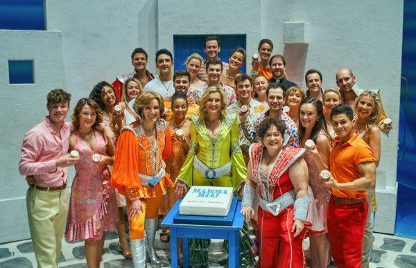 The London Cast of MAMMA MIA! on stage at the Novello Theatre for 19th Birthday, credit Gavin Nugent