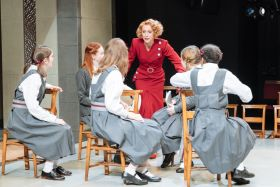 Lia Williams (Jean Brodie) and the company in The Prime of Miss Jean Brodie, Donmar Warehouse, directed by Polly Findlay, designed by Lizzie Clachan.