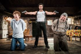 The Lieutenant of Inishmore, Noël Coward Theatre. Chris Walley (Davey), Aidan Turner (Padraic) & Denis Conway (Donny) Credit Johan Persson