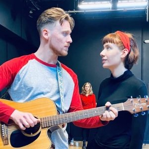 Darling, It's Not About You - Joel (Chris Mohan) and Susanna (Julia Thurston) in foreground, Michelle (Amy Leeson) in background